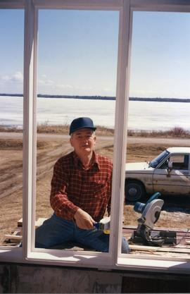 Henry Patkau painting the windows, Matheson Island