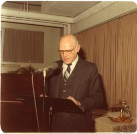 Alfred Dick giving a speech