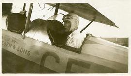 Edwin Friesen sitting in the cockpit of his airplane