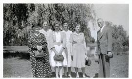 5 ladies and man standing under tree by a pond, in B.C.