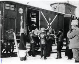 Wounded man being loaded onto Red Cross train
