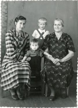 A family picture with 2 young boys and 2 women