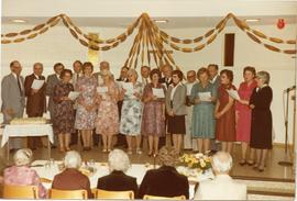 A choir singing at Aunt Dück's 90th birthday
