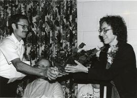 Jerry Shank presenting roses to Carol Norr