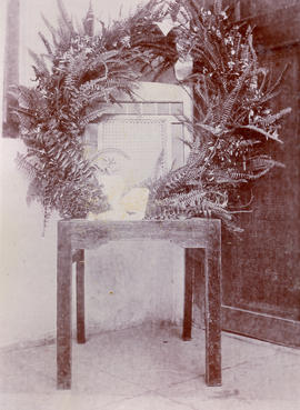 Garlanded chair of a deceased missionary in India