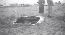 Car buried in sand by the Yuba City flood, 1956