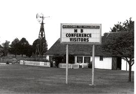 Sign welcoming delegates to the 1990 General Conference of MB Churches in Hillsboro, Kansas