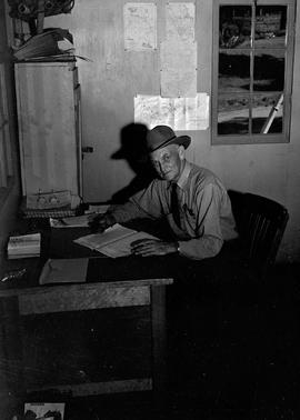 Unidentified administrator in office at Civilian Public Service Camp #31