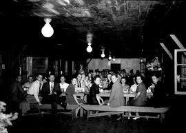 People seated at tables in dining hall at Civilian Public Service Camp #31