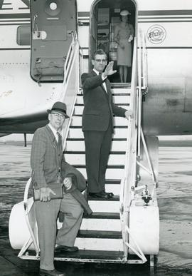 A. E. Janzen and J. B. Toews preparing to leave on airplane for mission board administrative trip