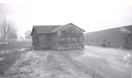 Building moved onto road by Yuba City flood, 1956