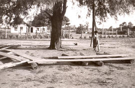 Indian church under Algarrobo tree at Indian mission station, with Indian school in background
