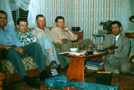 J. B. Toews (right) with four men seated on couch, probably from the Reedley Mennonite Brethren Church