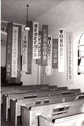Banners hanging in sanctuary of Dallas Mennonite Brethren Church