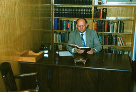H. R. Wiens in pastor's study at Reedley Mennonite Brethren Church