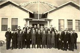 Unidentified group of men in front of Immanuel Bible School building