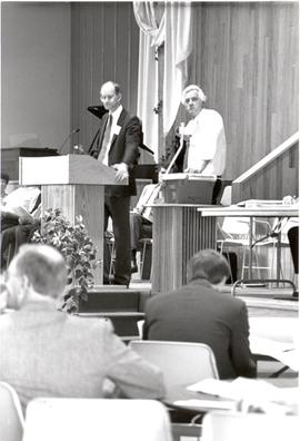 Jim Holm and Henry Schmidt during a session of the 1990 General Conference of MB Churches convention