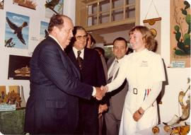 Paraguay president Alfredo Stroessner greets Ruth Gossen in front of display prepared by high sch...
