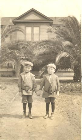Cousins Peter Ediger and Abe Ediger in front of house in Escondido, California