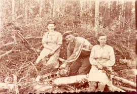 One man and two Mennonite women working in forest, Sverdlovsk Oblast, 1952.