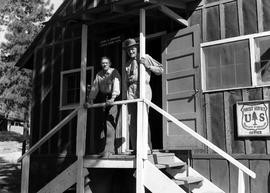 Two unidentified men standing on porch of building at Civilian Public Service Camp #31