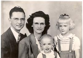 Chester and Elfrieda Fast, with their children Dale and Janet