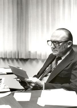 William Neufeld working at his office desk