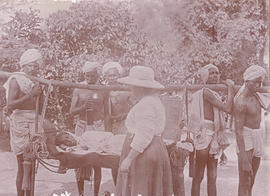 Indian men bringing a patient to the hospital on a stretcher