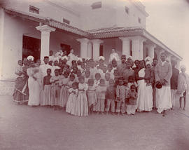 Katharina Schellenberg and another woman missionary with unidentified group of Indian people in N...
