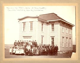 Corn Bible Academy students and teachers in front of school building