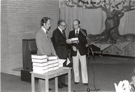 Peter Klassen and J. B. Toews present a copy of P. M. Friesen's Mennonite Brotherhood in Rus...