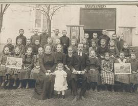 Teacher Abraham Bauer with his wife, daughter and class