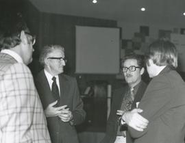 Four men in discussion