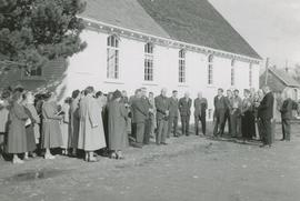 People at the side of the Church