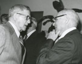 Two unknown men in discussion