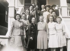 Fifteen girls on the front steps