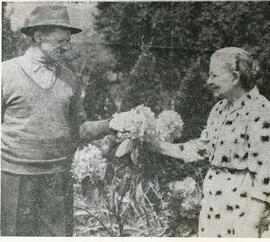 Nikolai and Sara (Peters) Reimer admiring roses