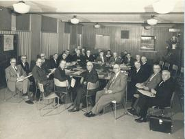 Meeting of 22 men and a woman