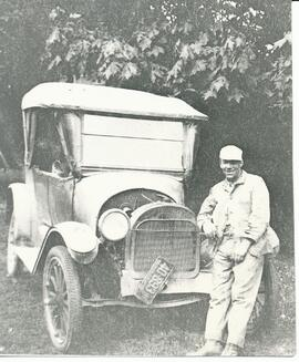 George Marshall Knox standing in front of his car