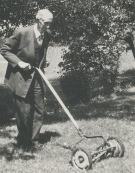 B.B. Janz cutting grass in his garden