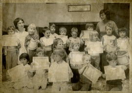 Children hHolding Certificates