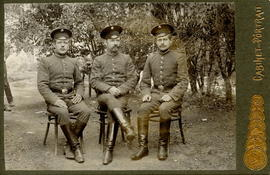 Three Men In Uniforms  Seated