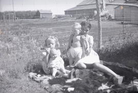 Three Children and a Doll
