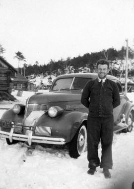 Man standing beside car