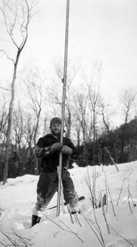 Conscientious objector assisting wtih surveying at Montreal River Camp