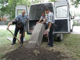 Moving tombstone from van to new location